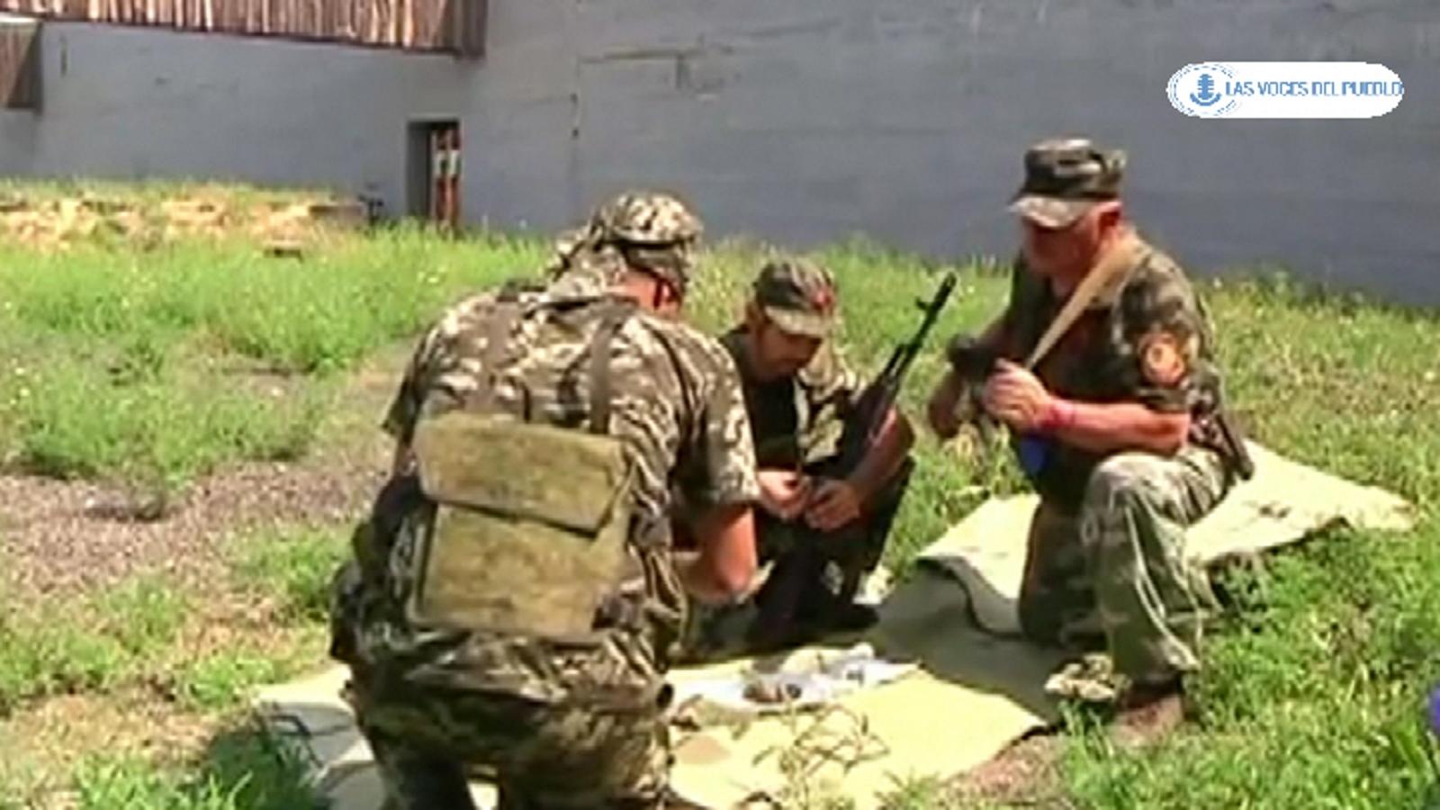 Dos españoles republicanos combatiendo con separatistas prorusos ucranianos contra el Gobierno de Kiev (13).Movie_Instantánea