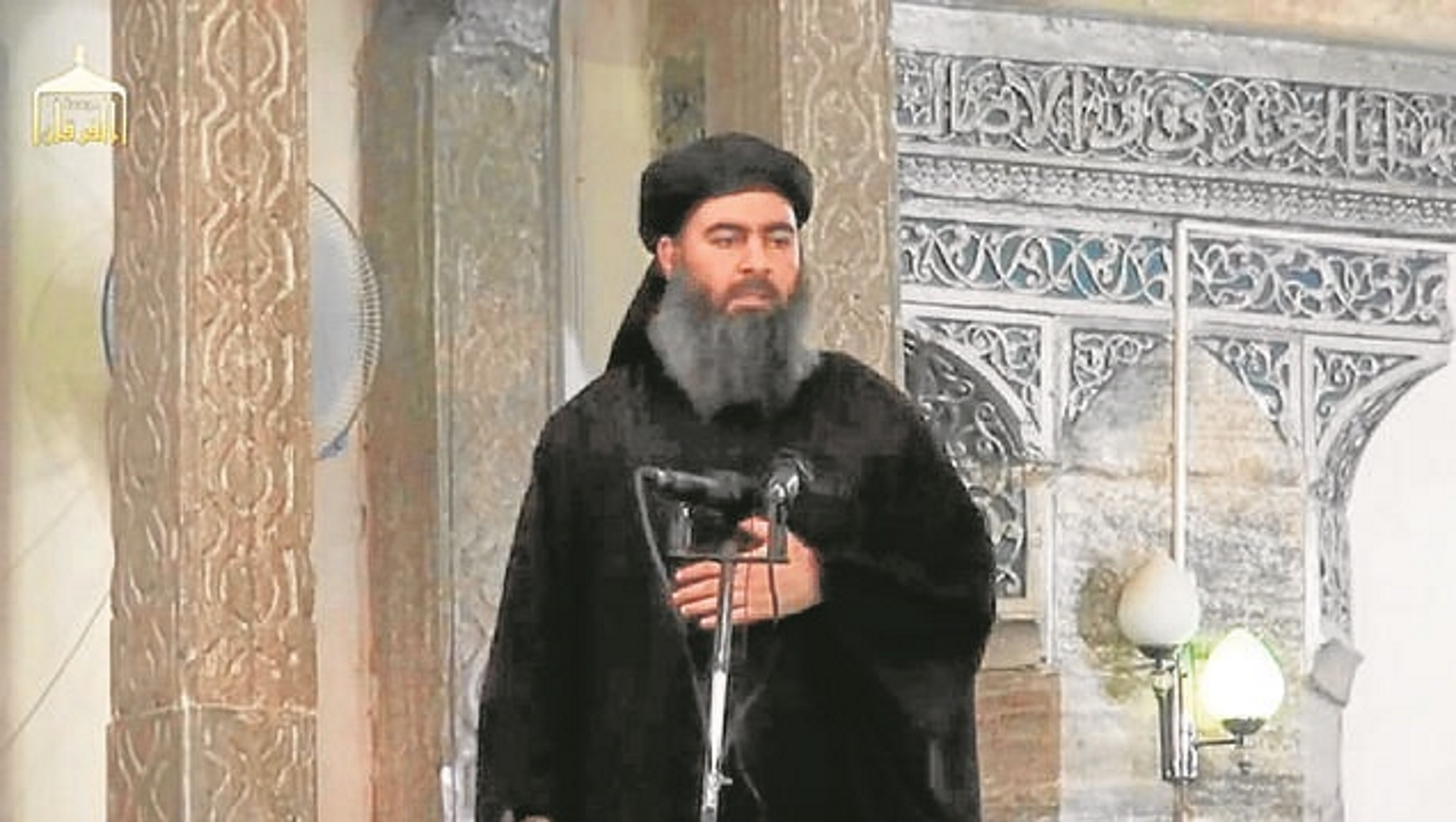 IRQ01. Mosul (Iraq), 05/07/2014.- A photograph made from a video released on 05 July 2014 by the jihadist affiliated group Furqan Media via their twitter account allegedly showing Islamic State (IS) leader Abu Bakr al-Baghdadi delivering a sermon during Friday prayers at a mosque in Mosul, Iraq, 04 July 2014. Abu Bakr al-Baghdadi, the ruler of the self-styled caliphate recently proclaimed by the jihadist Islamic State in Iraq and the Levant (ISIL), appears in a video said to be filmed inside a mosque in Mosul where he is delivering a sermon. Abu Bakr al-Baghdadi declared an Islamist caliphate in the territory under the group's control in Iraq and Syria earlier this week. (Siria) EFE/EPA/FURQAN MEDIA / HANDOUT BEST QUALITY AVAILABLE. EPA IS USING AN IMAGE FROM AN ALTERNATIVE SOURCE AND CANNOT PROVIDE CONFIRMATION OF CONTENT, AUTHENTICITY, PLACE, DATE AND SOURCE. HANDOUT EDITORIAL USE ONLY/NO SALES